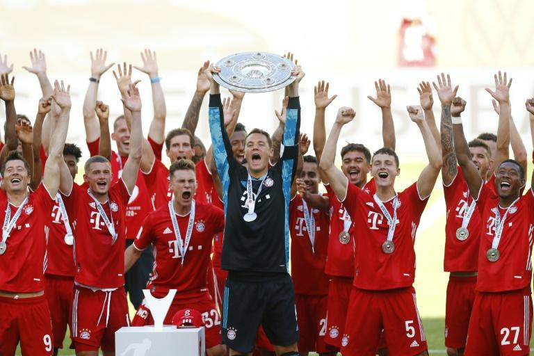Manuel Neuer lifts the Bundesliga trophy as Bayern celebrated an eighth German title in a row
