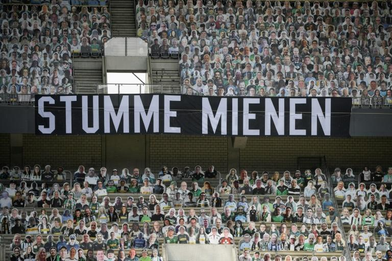 """A banner reading """"Silent Faces"""", surrounded by cardboard cut-out of Borussia Moenchengladbach fans, during Saturday's 3-1 home defeat to Leverkusen"""