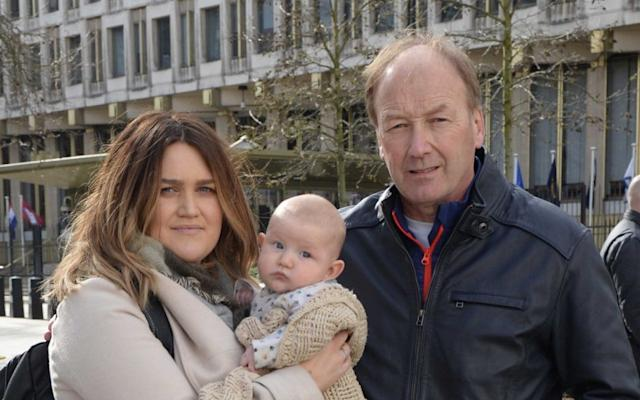Fern Kenyon-Cairns and her three-month-old son Harvey outside the US embassy in London, with grandfather Paul Kenyon - Steve Finn