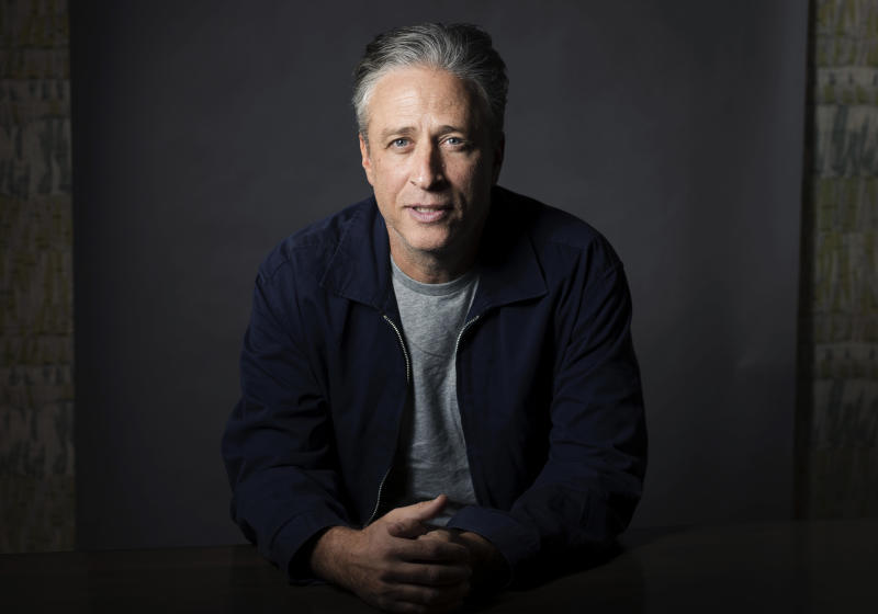 "FILE - In this Nov. 7, 2014 file photo, Jon Stewart poses for a portrait in New York. Stewart directed the comedy ""Irresistible,"" starring Rose Byrne and fellow ""The Daily Show with Jon Stewart"" alum, Steve Carell. (Photo by Victoria Will/Invision/AP, File)"