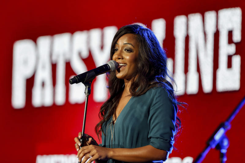 """FILE - This Jan. 15, 2017 file photo shows Mickey Guyton performing at the PBS's American Masters """"Patsy Cline"""" panel at the 2017 Television Critics Association press tour in Pasadena, Calif. What started as a joke on Twitter about an unwritten rule among country radio stations not to play two female artists in a row prompted outrage by country music stars, but also pledges to give women equal airtime. CMT announced on Tuesday, Jan. 21, 2020, that they would institute equal airplay for female artists across their two channels. And a country radio station in Ontario, Canada, started an equal play initiative for one week, pledging to split the airplay time 50-50 between men and female voices. (Photo by Willy Sanjuan/Invision/AP, File)"""
