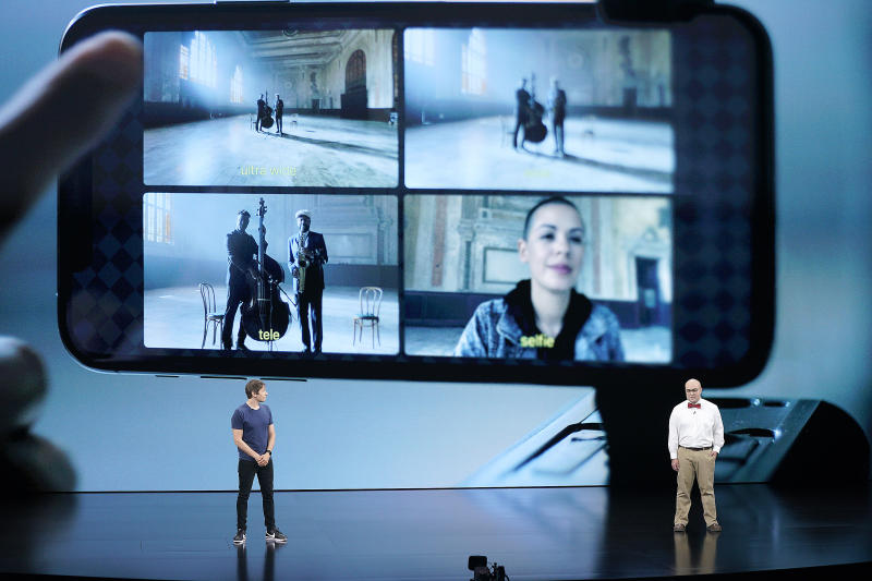 FiLMiC CTO Christopher Cohen, right, and filmmaker Sean Baker, left, explain how FiLMiC Pro utilizes all the cameras of iPhone 11 Pro during an event to announce new products Tuesday, Sept. 10, 2019, in Cupertino, Calif. (AP Photo/Tony Avelar)