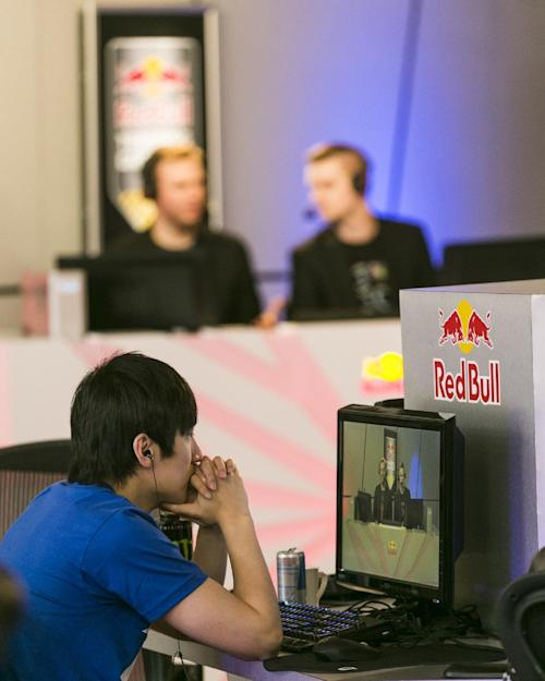 "In this photo taken Friday, June 21, 2013, legendary ""WarCraft 3"" player, Jo ""Golden"" Myeong Hwan, from South Korea, left, listens to casters Sean ""Day[9]"" Plott, and Mike ""Husky"" Lamond at the Red Bull Training Grounds, held at Red Bull North America headquarters in Santa Monica, Calif. The Red Bull TV e-sports series included live-streamed scrimmages and a tournament with $8,600 in prize money. (AP Photo/Damian Dovarganes)"