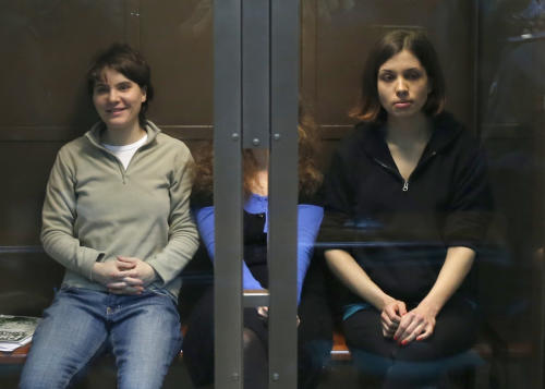 CORRECTS LEFT TO RIGHT Feminist punk group Pussy Riot members, from left, Yekaterina Samutsevich, Maria Alekhina, and Nadezhda Tolokonnikova sit in a glass cage in a court room in Moscow, Wednesday. Oct. 10, 2012. Three members of the punk band Pussy Riot are set to make their case before a Russian appeals court that they should not be imprisoned for their irreverent protest against President Vladimir Putin. Their impromptu performance inside Moscow's main cathedral in February came shortly before Putin was elected to a third term. The three women were convicted in August of hooliganism motivated by religious hatred and sentenced to two years in prison. (AP Photo/Sergey Ponomarev)