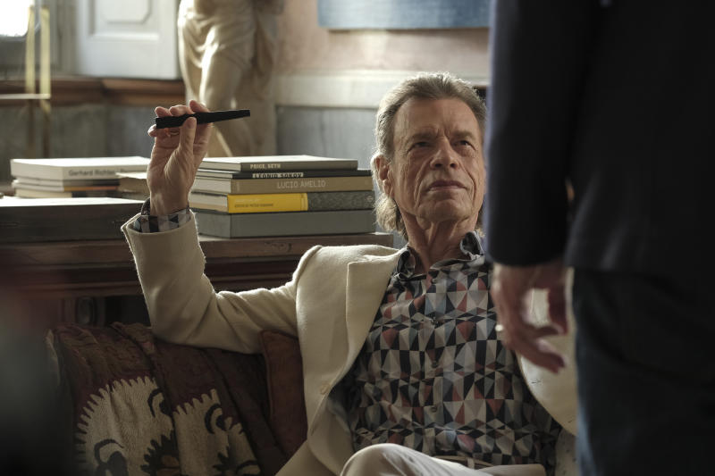 """This image released by Sony Pictures Classics shows Mick Jagger in a scene from the film, """"The Burnt Orange Heresy."""" This image released by Sony Pictures Classics shows Mick Jagger in a scene from the film, """"The Burnt Orange Heresy.""""  Jagger plays a devilish art collector who cunningly convinces an art journalist to use a rare interview with a reclusive artist as an opportunity to steal one of his paintings. It's Jagger's first film since 2001's """"The Man From Elysian Fields."""" (Jose Haro/Sony Pictures Classics via AP)"""