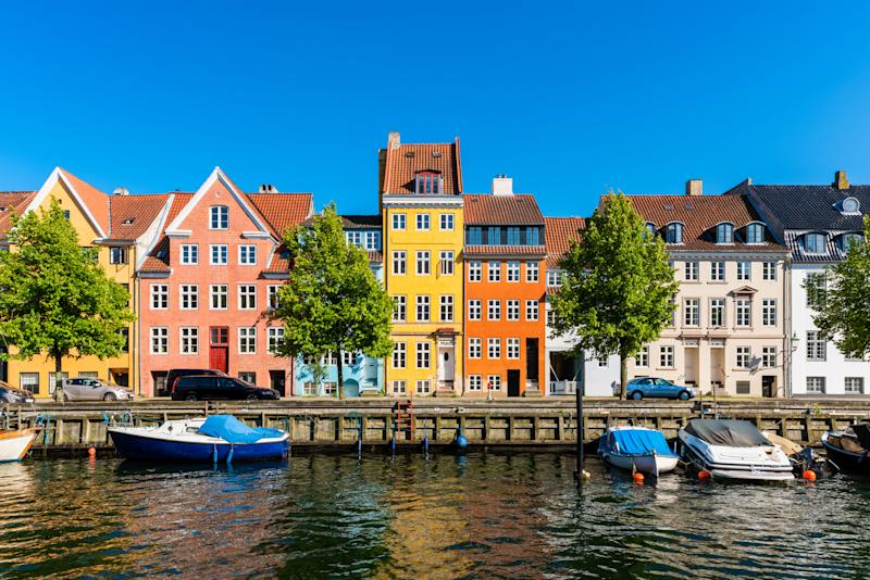 Colourful houses along canal in Downtown District of Copenhagen Denmark. Image: Getty