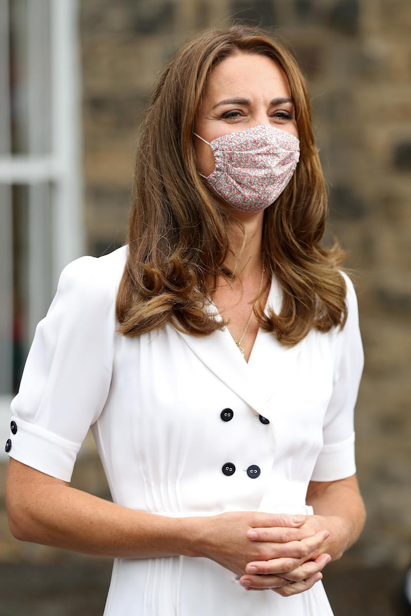 The Duchess wore a face mask was from Amaia London, and dress from Suzannah for her visit earlier this week. (PA Images)