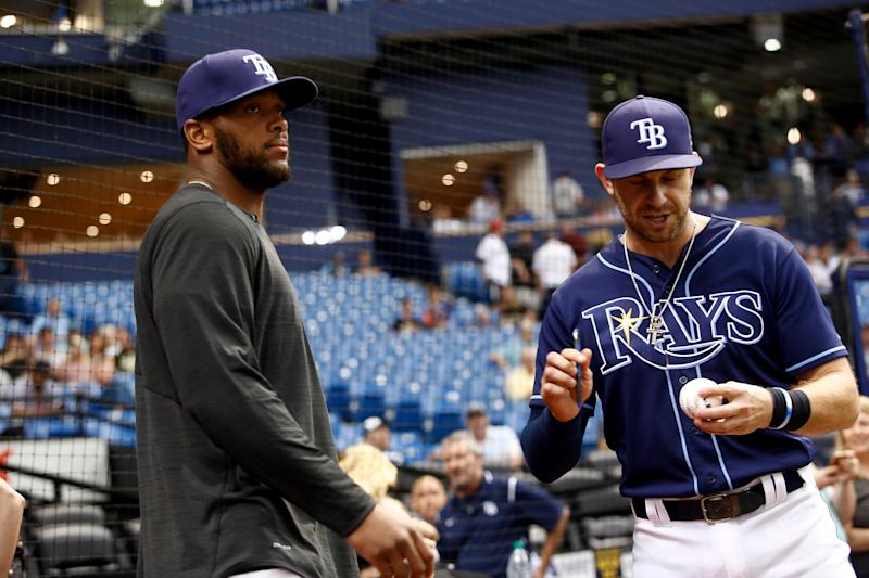 ST. PETERSBURG, FL - MAY 22: O.J. Howard (L) of the Tampa Bay Buccaneers hands an autographed baseball to Evan Longoria #3 of the Tampa Bay Rays moments before throwing out the ceremonial first pitch before the start of a game between the Rays and the Los Angeles Angels on May 22, 2017 at Tropicana Field in St. Petersburg, Florida. (Photo by Brian Blanco/Getty Images)