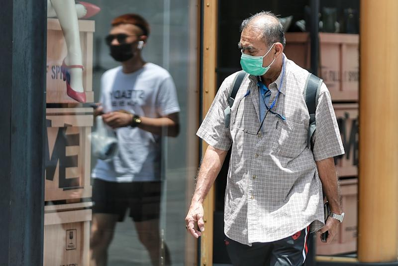The World Health Organisation is standing by its position on surgical masks, saying wearing one by itself was not a preventive measure against Covid-19. — Picture by Ahmad Zamzahuri