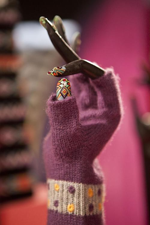Artificial fingernails and a glove are displayed at Gaga's Workshop, a collaborative fashion and lifestyle project between Lady Gaga and Barney's New York, at the Barney's store on East 60th Street in New York on Monday, Nov. 21, 2011. (AP Photo/Andrew Burton)