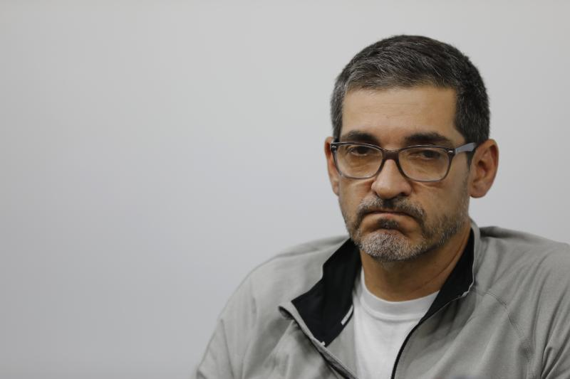 Carlos Villamizar, a DirecTV vice president, frowns while making a statement to reporters before turning himself over to authorities in Caracas, Venezuela, Friday, June 5, 2020. Venezuelan authorities have jailed Villamizar and two other local DirecTV executives under an arrest warrant issued after the Dallas-based company abruptly cut off services to the South American country last month, citing U.S. sanctions against the socialist government, the men's lawyer said Friday. (AP Photo/Ariana Cubillos)