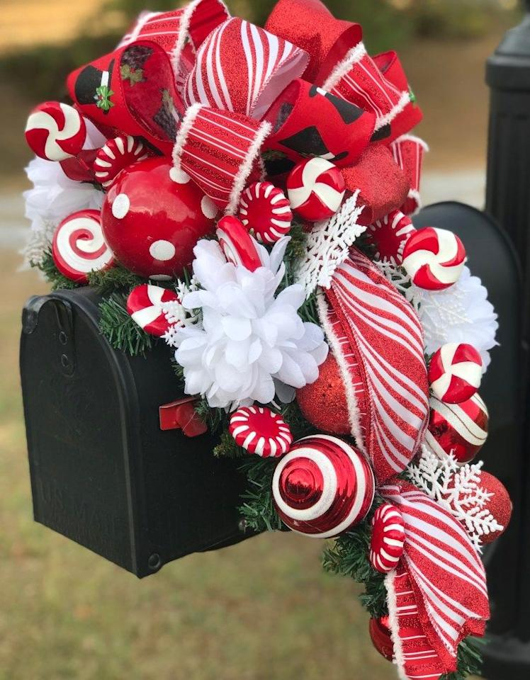 """<p>Bursting with holiday spirit, this project is easier to make than it looks thanks to a helpful video.</p><p><strong>Get the tutorial at <a href=""""https://gracemonroehome.com/how-to-make-a-christmas-mailbox-swag/"""" target=""""_blank"""">Grace Monroe Home</a>.</strong></p><p><strong><a class=""""body-btn-link"""" href=""""https://www.amazon.com/Darice-1619-61-10-Piece-Snowflake-Ornament/dp/B00GFW45TE/ref=asc_df_B00GFW45TE/?tag=syn-yahoo-20&ascsubtag=%5Bartid%7C10050.g.33605249%5Bsrc%7Cyahoo-us"""" target=""""_blank"""">SHOP PLASTIC SNOWFLAKES</a><br></strong></p>"""