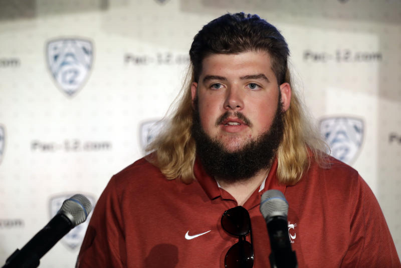 Washington State offensive lineman Liam Ryan answers question during the Pac-12 Conference NCAA college football Media Day Wednesday, July 24, 2019, in Los Angeles. (AP Photo/Marcio Jose Sanchez)