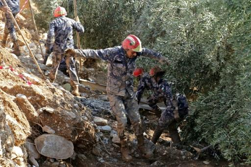 Jordanian rescue teams search for missing persons following flash floods in the city of Madaba near the capital Amman on November 10, 2018