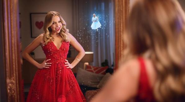 A photo of Bachelorette Australia 2019 Angie Kent wearing a red dress.