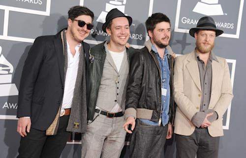 FILE - This Feb. 10, 2013 file photo shows, from left, Marcus Mumford, Ben Lovett, Country Winston and Ted Dwane, of Mumford & Sons, at the 55th annual Grammy Awards in Los Angeles. The Grammy-winning band announced Monday, June 24, rescheduled dates in Dallas, Woodlands, New Orleans and Kansas City. The upcoming shows will include bassist Ted Dwane, who received treatment for a blood clot on his brain two weeks ago. (Photo by Jordan Strauss/Invision/AP, file)