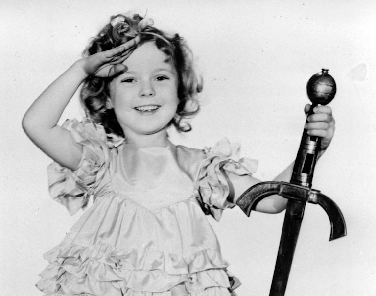 """FILE - In this 1933 file photo, child actress Shirley Temple is seen in her role as """"Little Miss Marker."""" Shirley Temple, the curly-haired child star who put smiles on the faces of Depression-era moviegoers, has died. She was 85. Publicist Cheryl Kagan says Temple, known in private life as Shirley Temple Black, died Monday night, Feb. 10, 2014, surrounded by family at her home near San Francisco. (AP Photo/File)"""