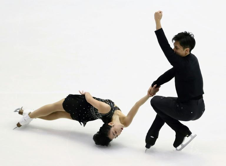 China's Sui Wenjing (R) and Han Cong of China easily won the pairs title at the Grand Prix of Figure Skating NHK Trophy in Sapporo