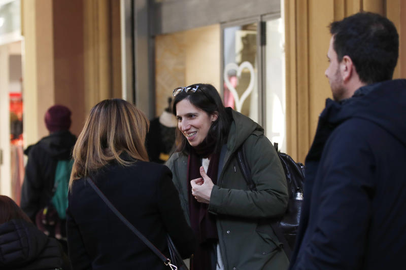 In this photo taken on Thursday, Jan. 30, 2020, Elly Schlein talks with people on a street after an interview with the Associated Press in downtown Bologna, Italy. A dual U.S.-Italian citizen who cut her political organizing teeth on two Barack Obama campaigns is emerging as the latest rising star in Italian politics.  (AP Photo/Antonio Calanni)