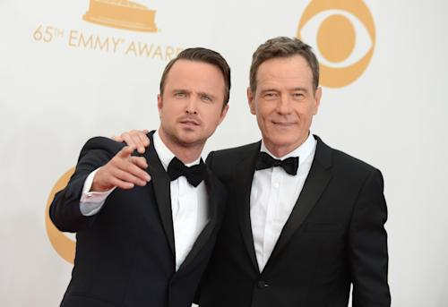 Aaron Paul, left, and Bryan Cranston arrive at the 65th Primetime Emmy Awards at Nokia Theatre on Sunday Sept. 22, 2013, in Los Angeles. (Photo by Jordan Strauss/Invision/AP)