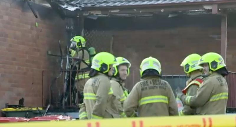Fire crews outside the smouldering Singleton home. Two girls, aged 5, and an 11-year-old boy died after the home went up in flames on Wednesday morning. A 31-year-old woman and an eight-year-old boy are in a stable condition at John Hunter Hospital.
