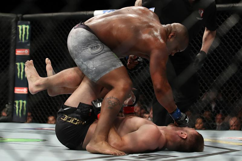 LAS VEGAS, NV - JULY 07: Daniel Cormier punches Stipe Miocic in their UFC heavyweight championship fight during the UFC 226 event inside T-Mobile Arena on July 7, 2018 in Las Vegas, Nevada. (Photo by Christian Petersen/Zuffa LLC/Zuffa LLC via Getty Images)