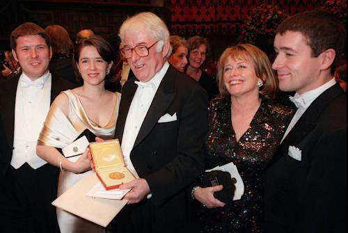 FILE - Sunday, Dec. 10, 1995 photo from files showing Irish poet Seamus Heaney, center, displaying his Nobel literature prize medal, surrounded by his family, from left: his son Michael, daughter Catherine, his wife Marie and son Christopher, after receiving it from the Swedish King Carl XVI Gustaf at the Concert Hall in Stockholm, Sweden. Seamus Heaney, Ireland's foremost poet who won the Nobel literature prize in 1995, has died after a half-century exploring the wild beauty of Ireland and the political torment within the nation's soul. He was 74. Heaney's family and publisher, Faber & Faber, say in a statement that Heaney died Friday in a Dublin hospital. (AP Photo/Eric Roxfelt, File)