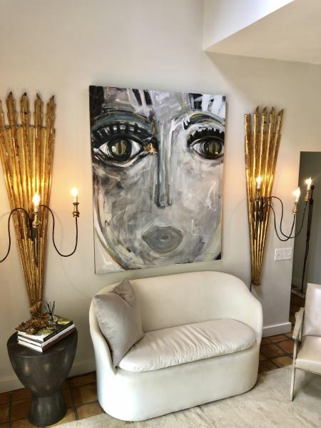 """This photo provided by Windy O'Connor shows one of her """"Chica"""" paintings hanging in her home in Charlotte, N.C. The fine artist often gives tiny versions of her paintings to friends as hostess gifts for the holidays. (Windy O'Connor via AP)"""