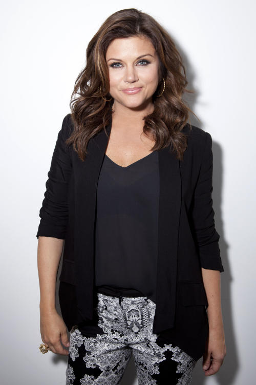 "This Feb. 6, 2013 photo shows actress Tiffani Thiessen posing for a portrait in New York. Thiessen, best known for her former role as Kelly Kapowski on TV's ""Saved by the Bell,"" says she had no idea at the time of how popular the show was. She says she's grateful she grew up in the limelight before TMZ and other 24 hour media outlets and gossip blogs came along. She currently stars in the USA series ""White Collar."" (Photo by Amy Sussman/Invision/AP)"