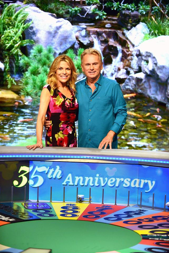 <p>It's now the longest-running syndicated game show in the country, and a lot of that success as to do with the quick wit of host Pat Sajak. Sajak is the longest-running host of any game show, a title he holds in the Guinness World Records. Even though Sajak has a long run, you really can't think of <em>Wheel </em>without the woman walking in by his side. Vanna White became the regular hostess in 1982, and even stepped in as a host in 2019 when Sajak had emergency surgery.</p>