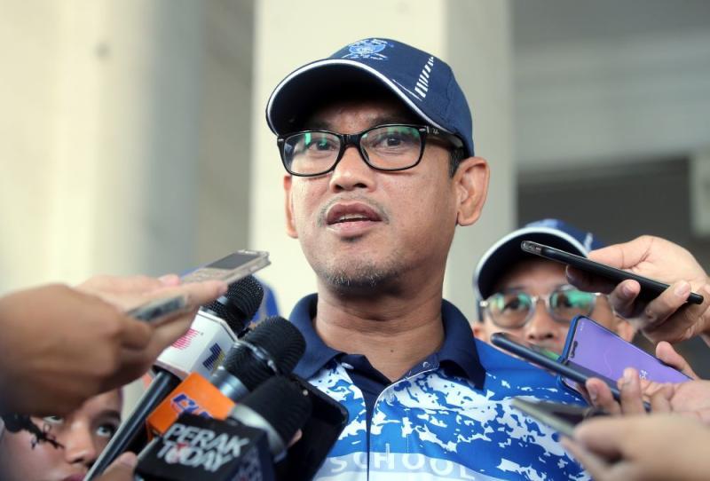 Perak Mentri Besar Datuk Seri Ahmad Faizal Azumu speaks to reporters during SMK Anderson's annual sports day in Ipoh March 15, 2019. — Picture by Farhan Najib