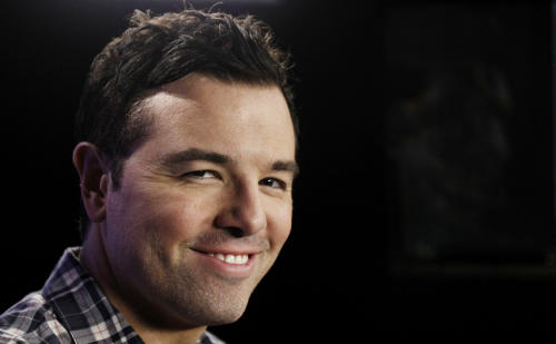 "In this Saturday, Oct. 1, 2011 photo, Seth MacFarlane poses for a portrait in Los Angeles. Fox, facing the ebbing ratings power of ""American Idol,"" is betting big on its first miniseries and shows from heavyweight producers MacFarlane and J.J. Abrams to invigorate its schedule. The network is making its largest original-programming investment yet with a crop of 11 new series along with the miniseries from filmmaker M. Night Shyamalan for the 2013-14 season, Kevin Reilly, Fox Entertainment chairman, said Monday, May 13, 2013. That's more than double the five series it announced last year. (AP Photo/Matt Sayles)"
