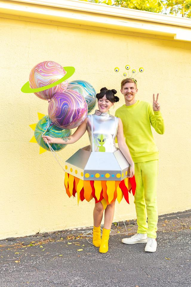 """<p>To make the alien portion of this costume, all you need is a neon sweatsuit and a matching alien headband. Extra points for carrying a bouquet of planet balloons.</p><p><em><a href=""""http://www.awwsam.com/2019/10/ufo-and-alien-couples-costume.html"""" target=""""_blank"""">Get the tutorial at Aww Sam »</a></em></p><p><strong>RELATED: </strong><a href=""""https://www.goodhousekeeping.com/holidays/halloween-ideas/g2625/halloween-costumes-for-couples/"""" target=""""_blank"""">80 Best Couples Halloween Costumes for Creative Duos</a></p>"""