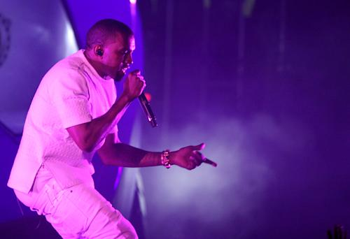 """FILE - In this July 1, 2012 file photo, Kanye West performs at the BET Awards in Los Angeles. West's new album """"Yeezus"""" is an artsy, dark adventure that isn't easy to digest. The 10 tracks are made up of moody, electronic and erratic beats, and lyrics about race and religion. (Photo by Matt Sayles/Invision/AP, File)"""