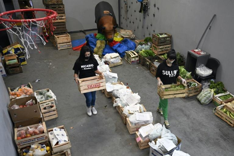Employees of children's party venue 'Nicansio Eventos' prepare fruit and vegetable orders for delivery after the venue was forced to convert itself into a greengrocers