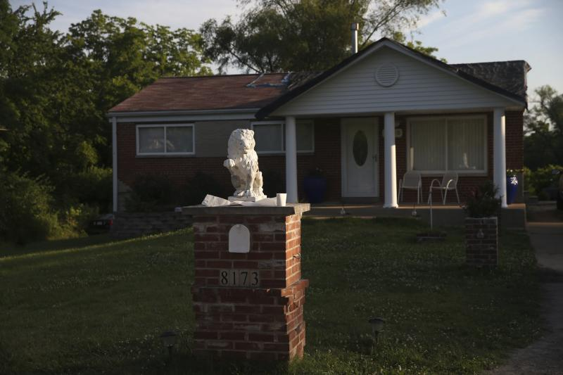 This Friday, June 26, 2020 photo, shows the front yard of a home in Kinloch, Mo. Authorities say a St. Louis rapper who went by the stage name of Huey has been killed in a double shooting at the suburban St. Louis home. Police identified him as 32-year-old Lawrence Franks Jr., although fans new him as Huey. A second victim remains hospitalized with non-life threatening injuries.   (Laurie Skrivan/St. Louis Post-Dispatch via AP)