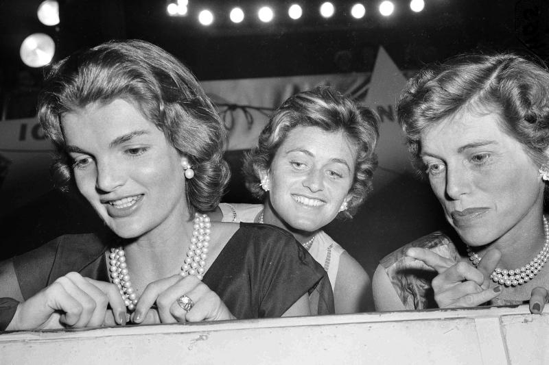 FILE - In this Aug. 14, 1956, file photo, from left: Jacqueline Kennedy, wife of Sen. John F. Kennedy (D-Mass.); Jean Kennedy Smith, the senator's sister; and Eunice Kennedy Shriver look on during the second day of the Democratic National Convention in Chicago. The death on Wednesday, June 17, 2020, of Jean Kennedy Smith, the last surviving sibling of President Kennedy, means Camelot's inner circle is almost gone. (AP Photo, File)