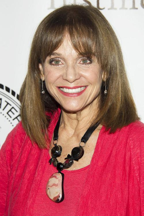 "FILE - This May 16, 2012 file photo shows actress Valerie Harper at the Friars Club Roast of Betty White in New York. The UP cable channel said Wednesday, July 31, 2013 that Valerie Harper is filming a TV movie in Canada. The movie, titled ""The Town that Came A-Courtin', is based on a novel by Ronda Rich and also stars Lauren Holly, Cameron Bancroft and Lucie Guest. (AP Photo/Charles Sykes, File)"