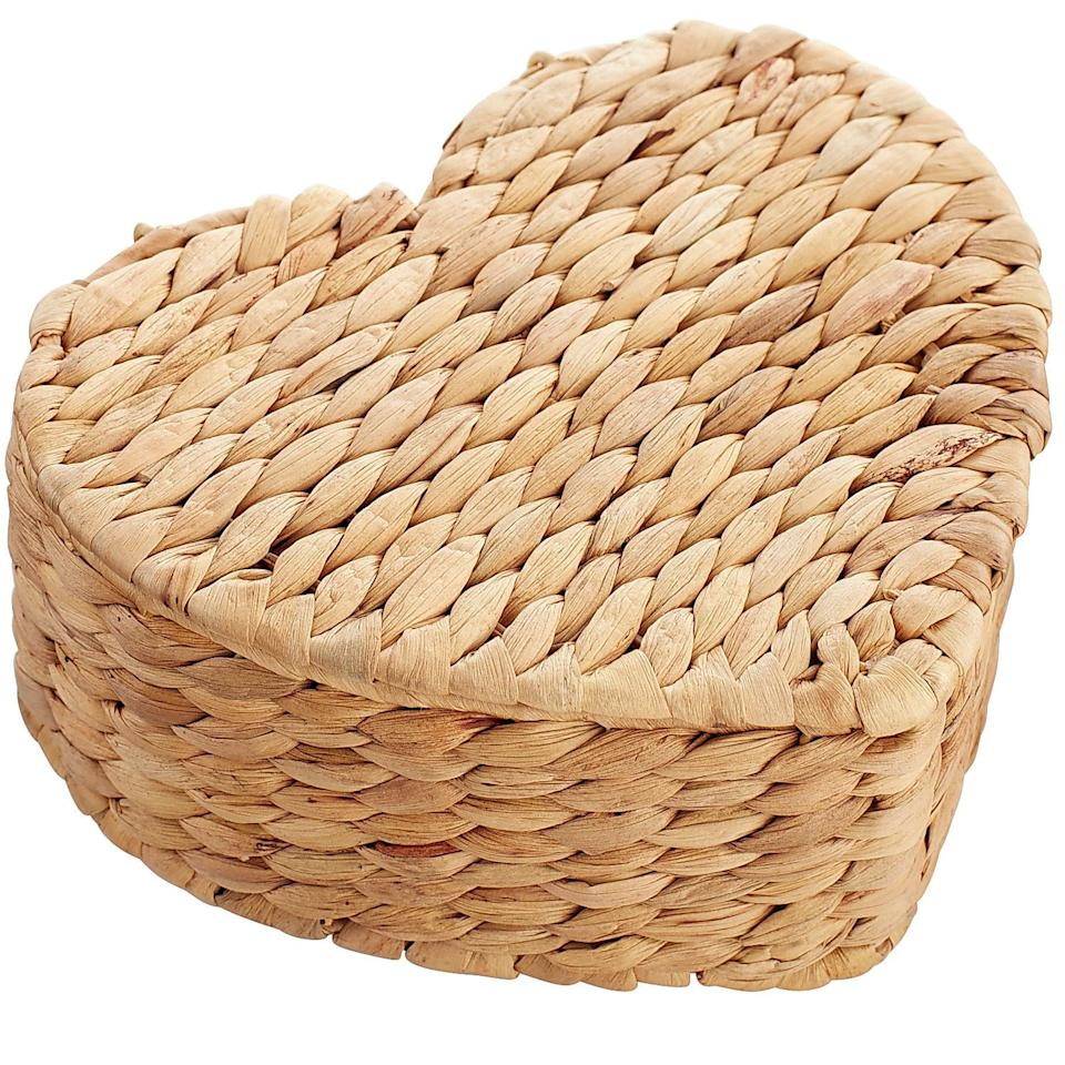 "<p>This <a rel=""nofollow"" href=""https://www.popsugar.com/buy/Natural%20Wicker%20Petite%20Heart%20Box-404475?p_name=Natural%20Wicker%20Petite%20Heart%20Box&retailer=pier1.com&price=15&evar1=moms%3Aus&evar9=45663736&evar98=https%3A%2F%2Fwww.popsugar.com%2Fmoms%2Fphoto-gallery%2F45663736%2Fimage%2F45663973%2FNatural-Wicker-Petite-Heart-Box&list1=shopping%2Cvalentines%20day%2Cdecor%20shopping%2Cpier%201%20imports&prop13=mobile&pdata=1"" rel=""nofollow"">Natural Wicker Petite Heart Box</a> ($15) makes a great jewelry holder.</p>"