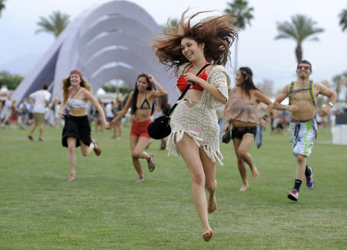FILE - This April 13, 2012 file photo shows festivalgoers running toward the main stage to catch the beginning of Kendrick Lamar's set during the first weekend of the 2012 Coachella Valley Music and Arts Festival in Indio, Calif. New music festivals are popping up more quickly than you can count in the U.S. Even as the summer festival season gets under way this week with the sprawling Coachella Valley Music and Arts Festival down in the desert in Indio, Calif., some of the most successful promoters in the scene are looking ahead to next year and beyond when they'll launch new ventures in untapped markets. (AP Photo/Chris Pizzello, file)