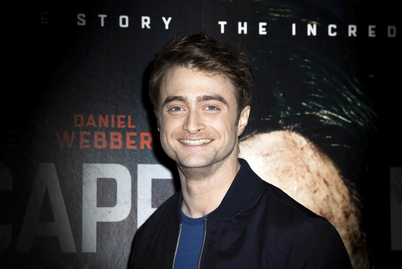 """FILE - In this Sunday, Feb. 16, 2020 file photo, actor Daniel Radcliffe poses for photographers upon arrival at a screening of the film """"Escape From Pretoria"""" in London. On Friday, March 13, 2020, The Associated Press reported on stories circulating online incorrectly asserting that actor Daniel Radcliffe tested positive for coronavirus. A Twitter account made to closely resemble that used by BBC Breaking News with the handle @BBCNewsTonight spread the claim, which was later retweeted by social media users, including celebrities on their verified accounts. Scott Boute, who represents Radcliffe, told The Associated Press in an email that the claim was not true. (Photo by Grant Pollard/Invision/AP)"""