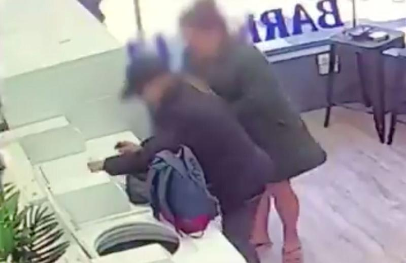 Two people are seen placing drugs on top of a washing machine at Barkly Street Laundromat in Melbourne's suburb of St Kilda.