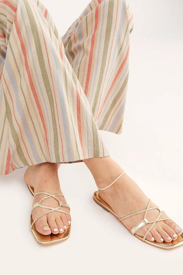 """<p>These <a href=""""https://www.popsugar.com/buy/FP-Collection-Santa-Monica-Slide-Sandals-575405?p_name=FP%20Collection%20Santa%20Monica%20Slide%20Sandals&retailer=freepeople.com&pid=575405&price=55&evar1=fab%3Aus&evar9=46281273&evar98=https%3A%2F%2Fwww.popsugar.com%2Ffashion%2Fphoto-gallery%2F46281273%2Fimage%2F47486763%2FFP-Collection-Santa-Monica-Slide-Sandals&list1=shopping%2Csandals%2Cshoes%2Cfree%20people%2Csummer%2Csummer%20fashion&prop13=mobile&pdata=1"""" rel=""""nofollow"""" data-shoppable-link=""""1"""" target=""""_blank"""" class=""""ga-track"""" data-ga-category=""""Related"""" data-ga-label=""""https://www.freepeople.com/shop/santa-monica-slide-sandals/?category=sandals&amp;color=070&amp;type=REGULAR&amp;quantity=1"""" data-ga-action=""""In-Line Links"""">FP Collection Santa Monica Slide Sandals</a> ($55) also come in a fun pink shade.</p>"""