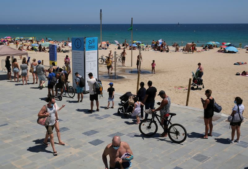 Spain scrambles to contain spiralling infections, salvage tourism season