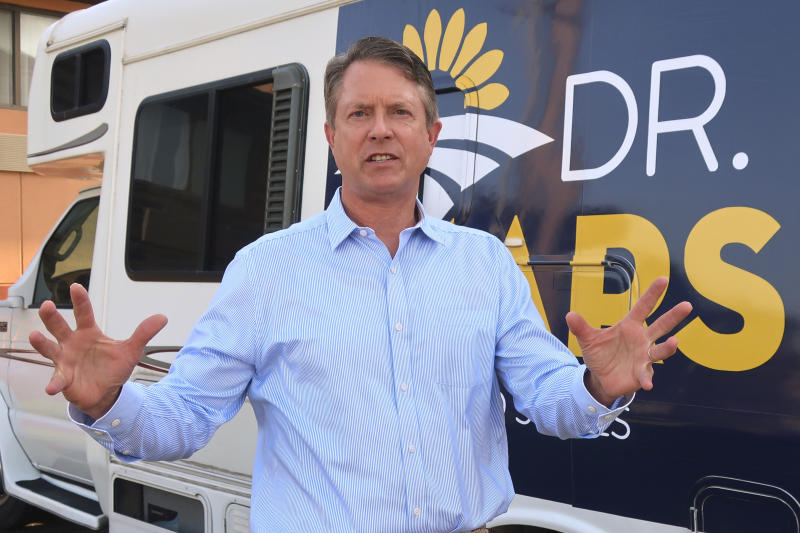 "FILE - In this Sept. 5, 2019 file photo, U.S. Rep. Roger Marshall, R.-Kan., speaks to an Associated Press reporter outside an RV he uses in traveling the state, during a visit to Topeka, Kansas. Political icon and 1996 Republican presidential nominee Bob Dole on Monday Jan. 13, 2020, endorsed western Kansas' congressman in the state's GOP Senate primary. Marshall's campaign announced Dole's backing and Dole tweeted that Marshall is ""a true friend to KS."" Marshall has served in Congress since 2017. (AP Photo/John Hanna,File)"