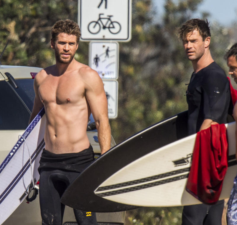 Liam Hemsworth topless with Chris Hemsworth in Byron Bay