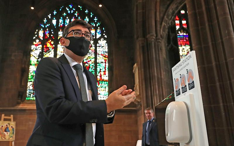 Andy Burnham, Mayor of Greater Manchester, sanitises his hands before a memorial service for the victims of coronavirus at Manchester Cathedral on July 16 - WPA Pool