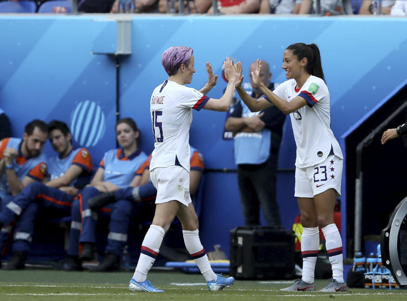 United States' Megan Rapinoe, left, is replaced by United States' Christen Press during the Women's World Cup final soccer match between US and The Netherlands at the Stade de Lyon in Decines, outside Lyon, France, Sunday, July 7, 2019. (AP Photo/David Vincent)