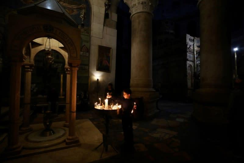 Jerusalem's Sepulchre church tells visitors to keep distance due to coronavirus