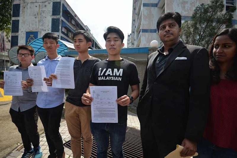 Universiti Malaya Association of New Youth (Umamy) president Wong Yan Ke and other UM students pose with the police report in front of Pantai police station March 23, 2019. — Picture by Shafwan Zaidon